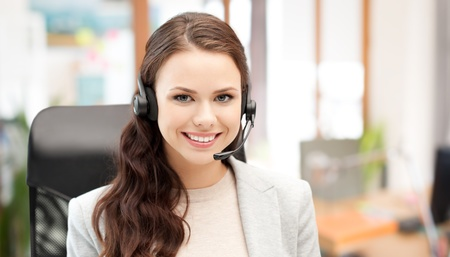smiling female helpline operator with headset